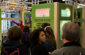 Graphic Design students see our designers' work on a trade show exhibit during AV Week